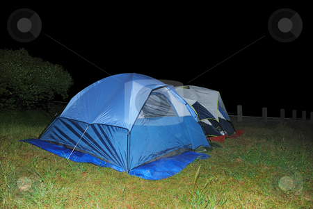 Two Tents at Night stock photo, Two blue tents on green grass at night. by Denis Radovanovic