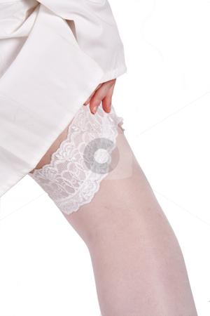Sexy nurses leg in white stocking on white background stock photo, Portrait of a sexy nurses leg with white stocking by Frenk and Danielle Kaufmann