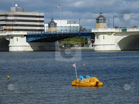Empty Paddle Boat  stock photo, Empty Paddle Boat in the Maumee River with Toledo Ohio's Martin Luther King Bridge  in the background. (aka Cherry Street Bridge). by Dazz Lee Photography