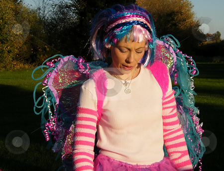 Lollipop Fairy stock photo, Lollipop Fairy, woman dressed as a colorful fairy. She handed out lollipops to all the children at a Childen's Halloween Event out in the Country. by Dazz Lee Photography