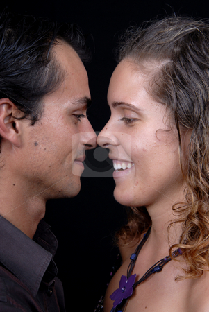 Kiss stock photo, Young couple together portrait on black background by Rui Vale de Sousa