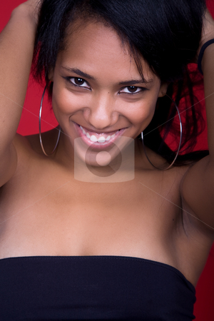 Happy stock photo, Young beautiful woman closeup portrait, on a red background by Rui Vale de Sousa