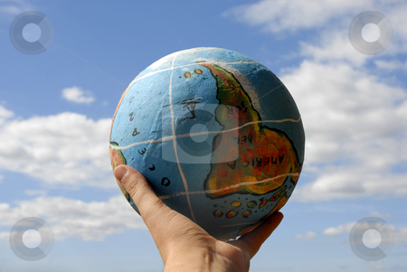 Globe stock photo, Globe in a woman's hand and the sky by Rui Vale de Sousa