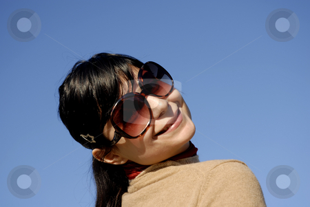 Happy stock photo, Happy casual woman portrait withe the sky as background by Rui Vale de Sousa