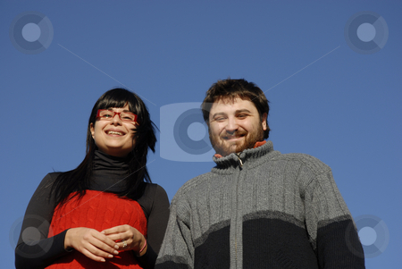 Couple stock photo, Young couple with the sky as background by Rui Vale de Sousa