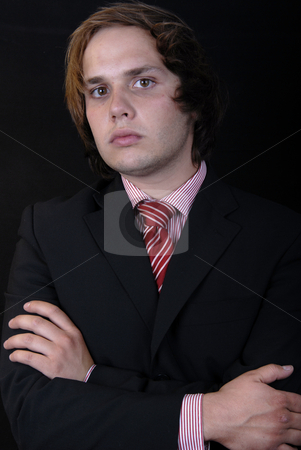 Mad stock photo, Young business man portrait on black background by Rui Vale de Sousa