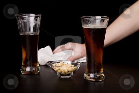 Cleaning stock photo, Glass of beer with a waitress cleaning on the background by Rui Vale de Sousa