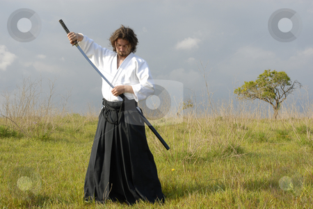Aikido stock photo, Young aikido man with a sword, outdoors by Rui Vale de Sousa