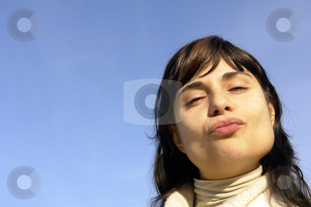 Kiss stock photo, Woman portrait with the sky as background by Rui Vale de Sousa