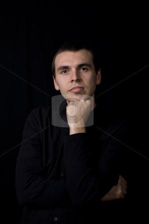 Pensive stock photo, Young pensive man portrait, on a black background by Rui Vale de Sousa
