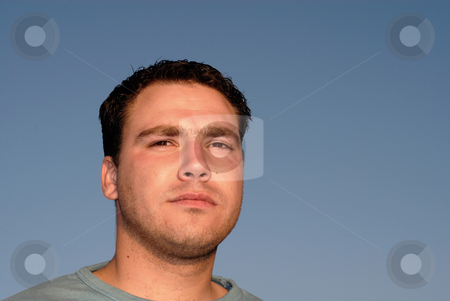Close stock photo, Silly young man with sky as background in sunset light by Rui Vale de Sousa