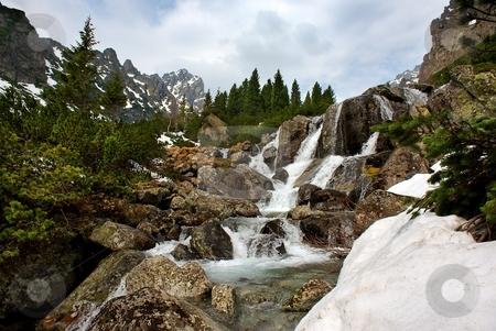 Creek in mountains stock photo, Creek in mountains, small waterfall by Juraj Kovacik