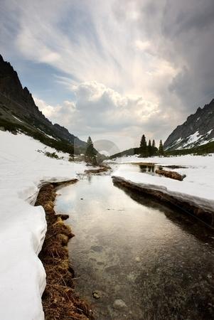 Mountains creek stock photo, Mountain creek and clouds reflection by Juraj Kovacik