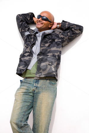 Smile stock photo, Young casual man with as white wall as background by Rui Vale de Sousa