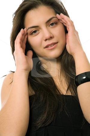 Headache stock photo, Young casual woman portrait with a headache by Rui Vale de Sousa