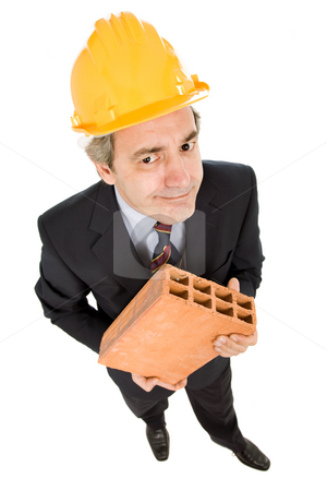 Brick stock photo, Mature worker holding a brick, isolated on white by Rui Vale de Sousa