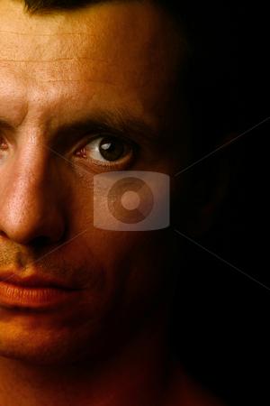 Half a mans face stock photo, Young man close up portrait, on black background by Rui Vale de Sousa