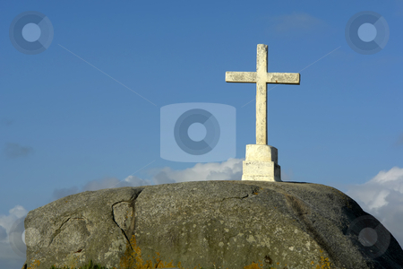 Cross stock photo, Rock cross and the clouds at the blue sky by Rui Vale de Sousa