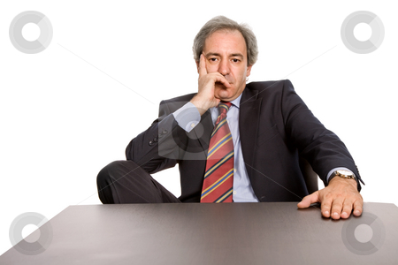 Bored stock photo, Mature business man on a desk, isolated on white by Rui Vale de Sousa