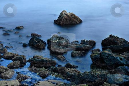 Aquatic stock photo, Long Exposure of sea over rocks - dreamy feel by Rui Vale de Sousa
