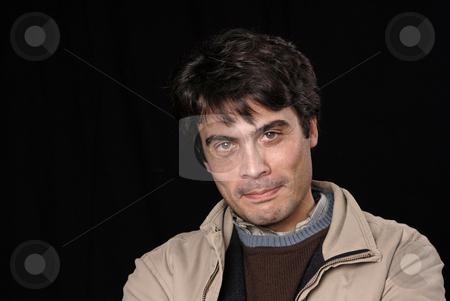 Portrait stock photo, Crazy young man portrait isolated on black by Rui Vale de Sousa