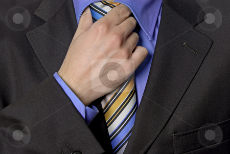 Hand tie stock photo, Detail of a Business man Suit with colored tie by Rui Vale de Sousa