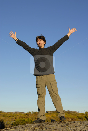 Open stock photo, Young man with arms wide open and the sky as background by Rui Vale de Sousa