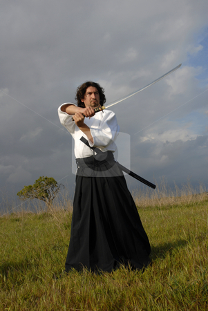 Fighter stock photo, Young aikido man with a sword, outdoors by Rui Vale de Sousa