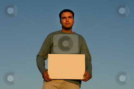 Add stock photo, Young man with an empty white card by Rui Vale de Sousa
