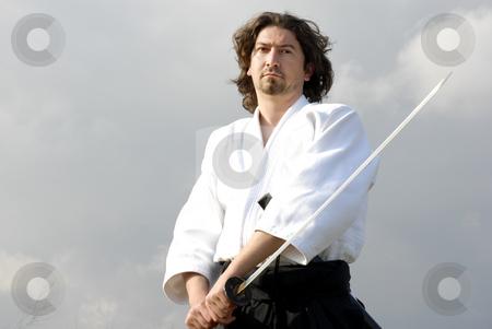 Samurai stock photo, Young aikido man with a sword, outdoors by Rui Vale de Sousa