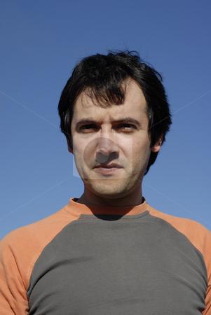 Portrait stock photo, Man portrait against the sun over a clean blue sky by Rui Vale de Sousa