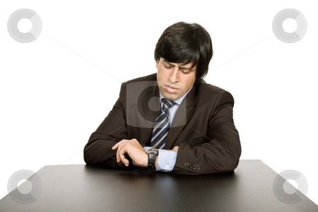 Worried stock photo, Young worried businessman on a desk, isolated on white by Rui Vale de Sousa