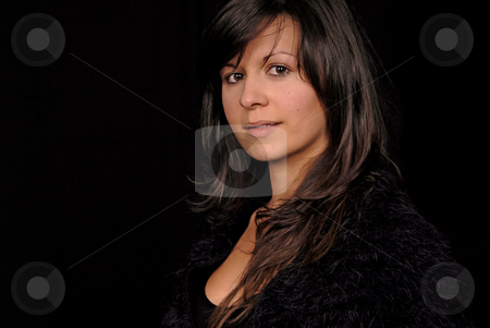 Woman stock photo, Young woman portrait posing in black background by Rui Vale de Sousa
