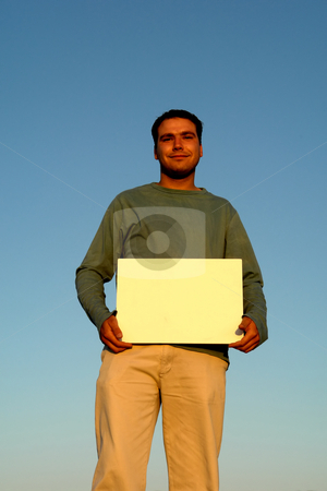 Add stock photo, Man with white card in sunset light by Rui Vale de Sousa