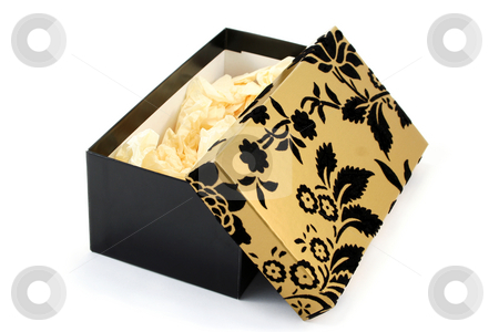 Open Black and Gold Gift Box stock photo, Black and gold cardboard gift box, opened and showing tissue paper inside by Helen Shorey