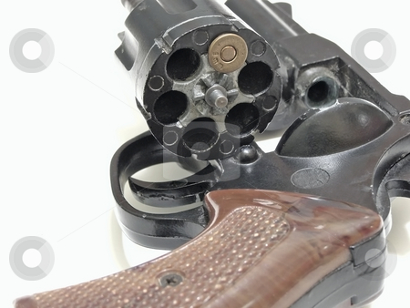 Russian roulette stock photo, Open cylinder of revolver with one bullet inside by Sergej Razvodovskij