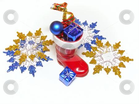 Multicolored Christmas decorations stock photo, A lot of multicolored decorations and sweets in Christmas boot by Sergej Razvodovskij