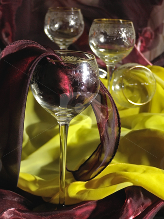 Wineglasses and tissue stock photo, Wineglasses against the red and yellow tissue by Sergej Razvodovskij
