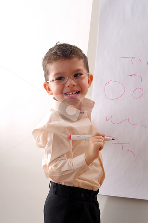 Little boy  stock photo, Little boy writing on whiteboard by Dragos Iliescu