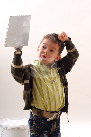 Small boy in construction stock photo, Small boy working in construction by Dragos Iliescu