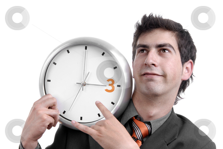 Silly stock photo, Young handsome business man holding a clock by Rui Vale de Sousa