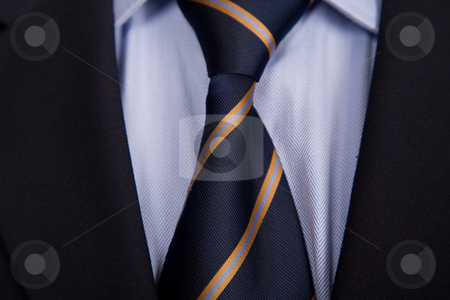 Necktie stock photo, Detail of a business man suit with blue tie by Rui Vale de Sousa