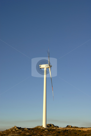 Turbine stock photo, White wind turbine in the top of the mountain by Rui Vale de Sousa