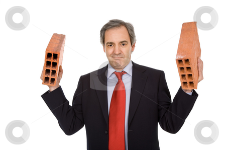 Bricks stock photo, Mature business man with two bricks, on white by Rui Vale de Sousa