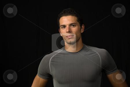 Portrait stock photo, Young man portrait, on a black background by Rui Vale de Sousa