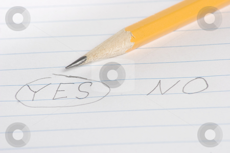 Choose yes or no stock photo, The word yes is circled by a pencil by Matt Baker