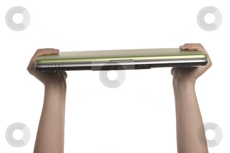 A womans hands holding a laptop stock photo, A womans hands are holding a laptop high overhead by Matt Baker