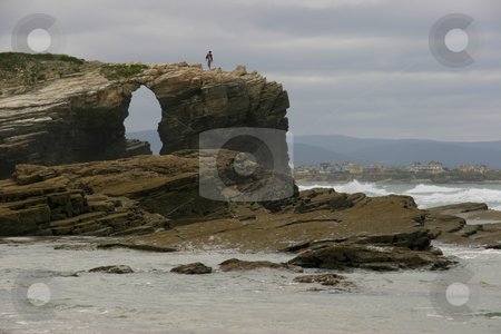 Cave stock photo, Cave on a beach rock in the coast of spain by Rui Vale de Sousa
