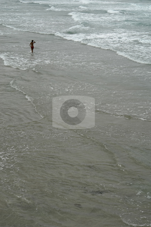 Beach stock photo, Woman at the beach with lots of waves by Rui Vale de Sousa
