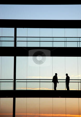 People stock photo, Two workers inside the building silhouette at sunset by Rui Vale de Sousa